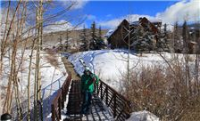 Mountain Lodge Telluride - Lone Skier Walking Across Bridge
