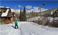 Mountain Lodge Telluride - Lone Skier at End of Day by Cabin 10